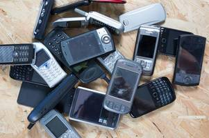 warning after hundreds of counterfeit mobile phones with hazardous chargers are seized