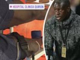 Man City defender Benjamin Mendy bends his injured knee