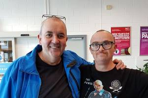 charming moment darts superfan meets his idol phil 'the power' taylor in hull
