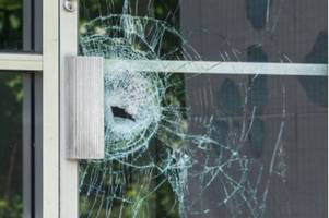 man smashes council office window with golf club