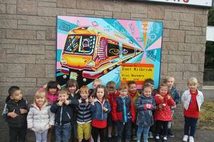 east kilbride tots win national award for town's colourful railway station murals
