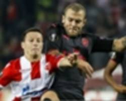 'i told you we have some' – wilshere snaps back at deeney after belgrade win