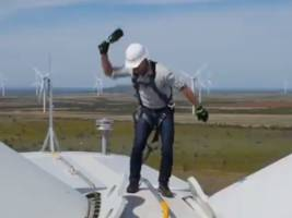 Here's a video of Jeff Bezos smashing a champagne bottle on a windmill