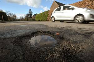 potholes in surrey: new figures reveal the true depth of surrey's pothole epidemic - and it's deeper than the english channel