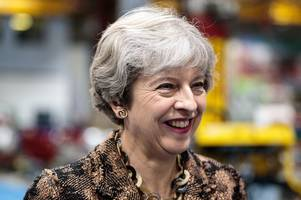 prime minister theresa may backs project coming to guildford which aims to combat modern slavery