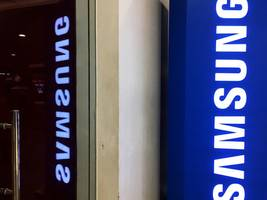 samsung is under scrutiny again as south korean police raid offices