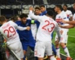 WATCH: Fan carrying child gets involved in Everton-Lyon players' brawl