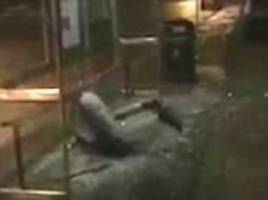 man hurls himself through glass of cardiff bus stop
