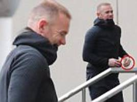wayne rooney sports wedding ring while out in manchester