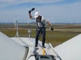 Amazon's Jeff Bezos smashes champagne bottle on turbine