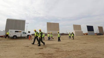 photos: prototypes of trump's border wall go up in san diego