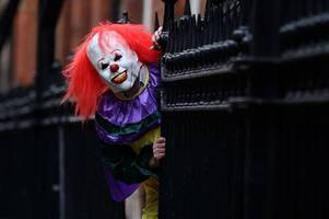 creepy clowns spotted scaring kids outside primary school