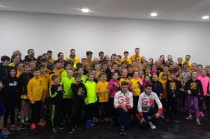 athletics: east kilbride kids inspired after visit from team gb olympians