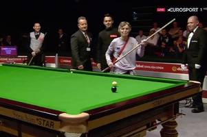 ronnie o'sullivan is good sport as fan storms snooker game and tries to pot the black