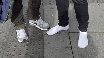 shoes gift to homeless man is 'passed on' around world