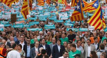 450,000 take to barcelona's streets, led by catalan separatist president, chanting time to declare independence