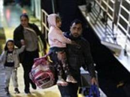 200 migrants arrive in athens after crossing from turkey
