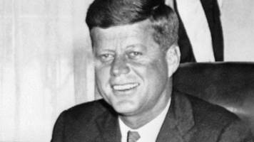 Trump says he will allow scheduled release of JFK files