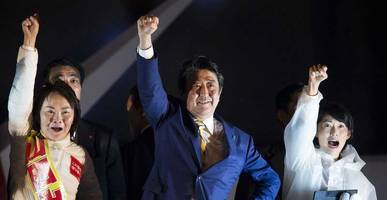 exit polls project sweeping victory, supermajority for japan's abe