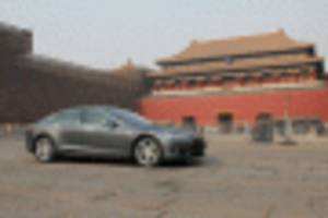 report: tesla receives approval for chinese plant