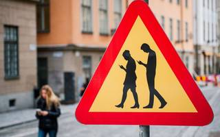 heads up: texting while crossing roads will now get you fined in this city