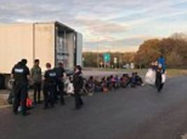 police find 15 illegal immigrants stowed away in lorry