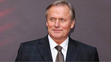 john grisham on president trump: 'these are the easy days'