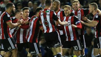 sub brooks sends sheffield utd top of the championship