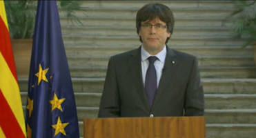 catalan leader urges peaceful rebellion as spain takes over government