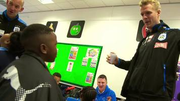 match of the day: huddersfield players serving up school breakfasts