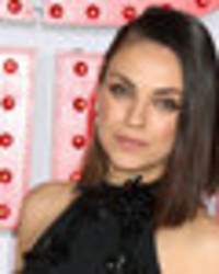 thigh's the limit! mila kunis sizzles in dress slashed to crotch