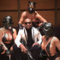 floyd mayweather poses with three scantily clad women wearing leather masks