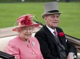 Prince Philip is spotted riding a horse and carriage