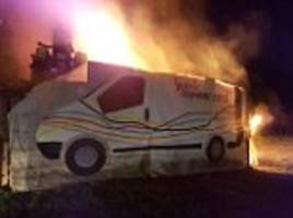 angry villagers torch a huge effigy of a bt van in devon