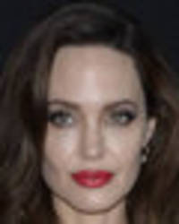 angelina jolie drops jaws as she bares nipples in stunning silk gown