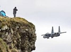 US F-15 Eagle fighter jet snapped flying close to a cliff