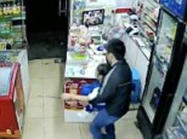 man is caught on cctv grabbing a young girl from a shop