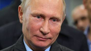 Putin: Doping allegations 'US plot against Russian election'