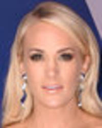 Carrie Underwood shows off ample assets in dazzling off-the-shoulder gown