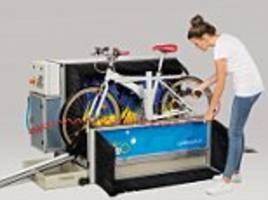 car wash-style booth that cleans up muddy bikes in uk