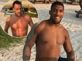 anthony joshua performs bizarre neck exercises