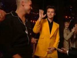 x factor: harry styles baffles fans with odd yellow suit