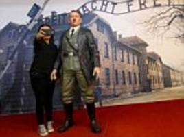 Museum removes waxwork of Hitler posing at Auschwitz gates