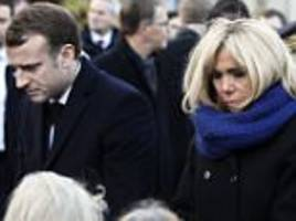 emmanuel macron consoles relatives of paris attack victims