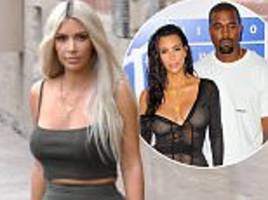 kim kardashian and kanye west 'rarely visit surrogate'