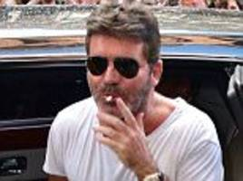 simon cowell cuts down from 80 cigarettes to two a day