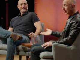 Watch Amazon CEO Jeff Bezos and his younger brother give a rare interview about growing up together (AMZN)