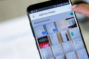 Adobe Scan now uses AI to surface docs, business cards, and receipts in your camera roll