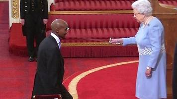 arise, sir mo - watch farah being knighted by the queen