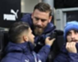 Low hails De Rossi's moment of 'greatness' in refusing to enter match